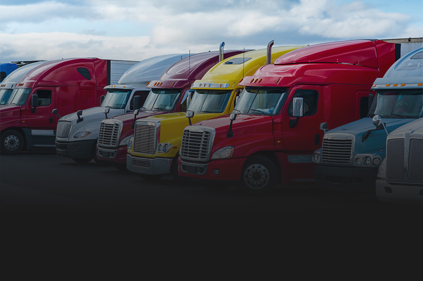Colourful shipping trucks lined up in Hamilton lot